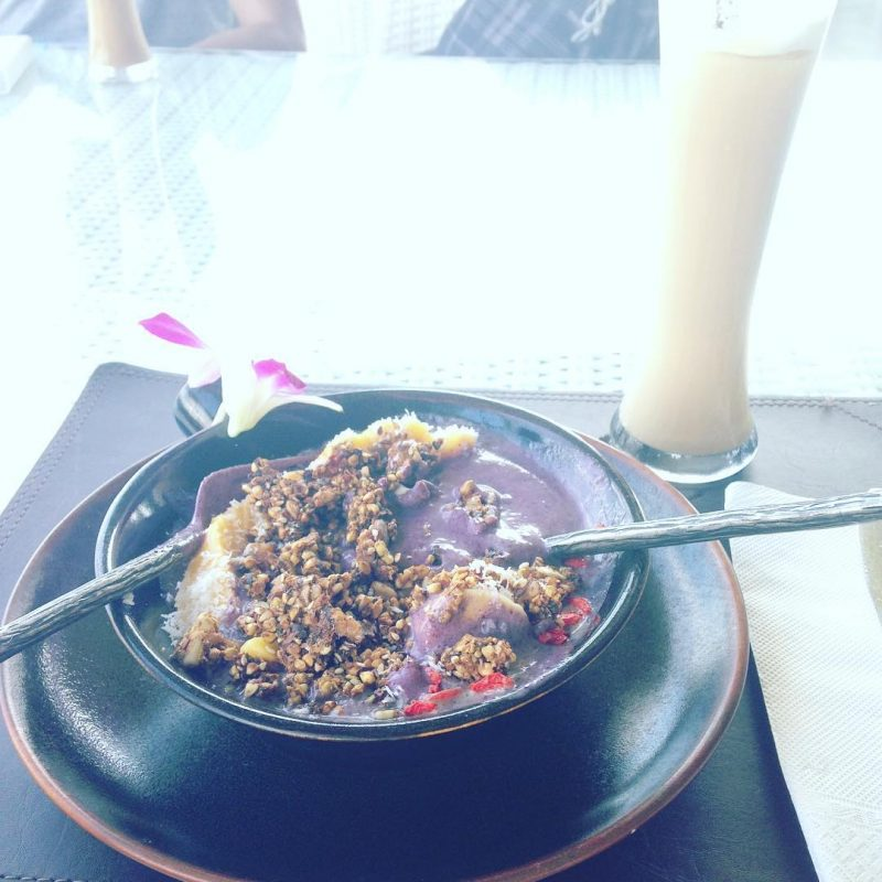 After yoga class, we are eating healthy super bowl: blueberry yogurt, banana, mango, chocolate granola.