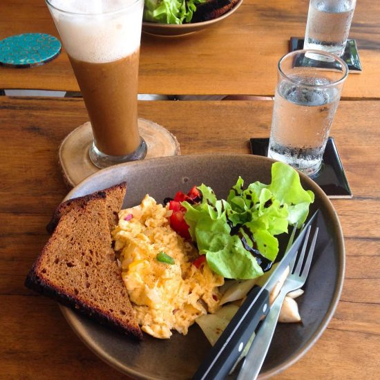 Breakie time 🌴🌿😍💕 scrambled eggs with whole grains bread 🍞 and iced latte with almond milk