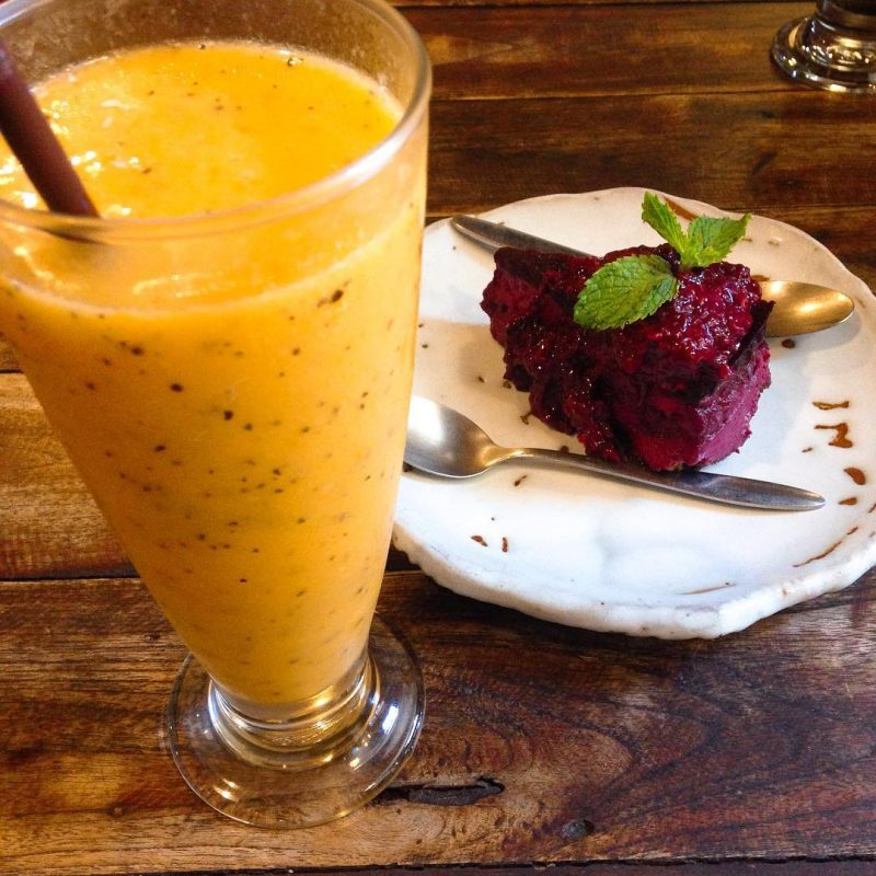 Yummy passion fruit, orange, mango smoothie and raw cake