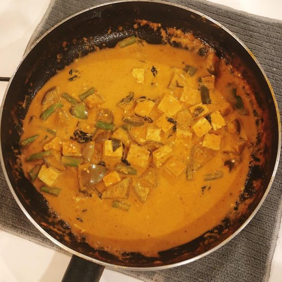 Dinner time: vegetarian panang curry with salmon steak, served with rice berry. This is a fusion panang curry recipe as I like to be creative in the kitchen and try mixing things that taste good together. I hope you enjoy it. . Ingredients for vegetarian panang curry: 3 small Thai eggplants  String beans  Thai basils  kaffir lime leaves tofu  2-3 gloves of garlics  panang curry paste  full fat coconut milk  3 tablespoons soy sauce (optional) masala (optional) cumin . Directions: spray the pan with olive oil  Fry garlics  Add tofu and cook them for 2-3 mins  Add panang paste and a half box/can of coconut milk , mix them well and wait until the curry starts boiling.  add eggplants, string beans, kaffir lime leaves, Thai basils  Stir everything together and wait until the curry starts boiling, lower the heat and leave it around 7-10 mins. Done