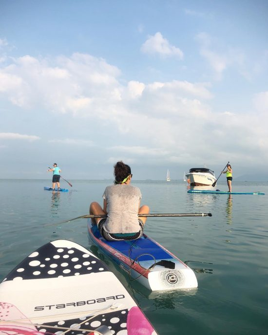 Morning SUP with friends and secret SUP ladies' group  Markus and Ali did 8k morning workout paddle to close by Koh Som and back to Bangrak beach.  I was paddling around Bangrak beach with Marie, KL and Tammy. They were practicing their race boards today. I was on my yoga board. 😆🏝🏖🌊