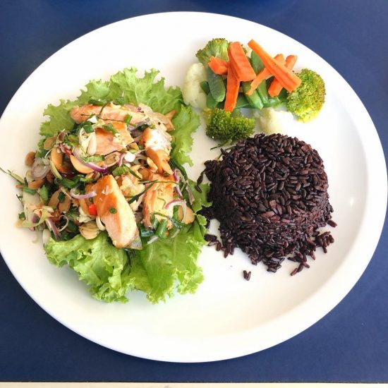 Yummy spicy salmon salad with rice berry and power (Buddha) bowl at Coffee cup Bangrak